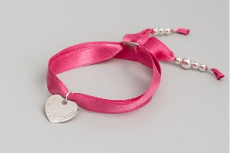 Mini Faubourg coeur 1.5cm en argent sur satin.